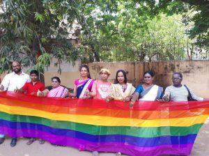 LGBTQIA activists with the rainbow flag - The Federal