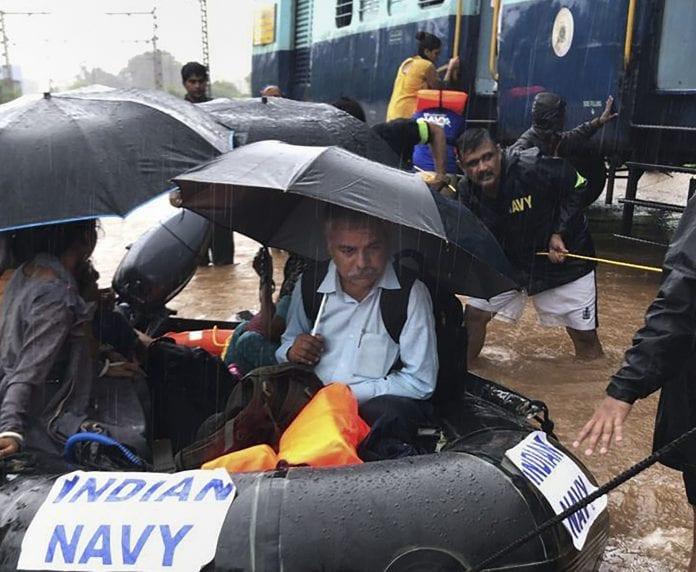 train stuck, Mumbai rains, passengers rescued, navy, The Federal, English news website