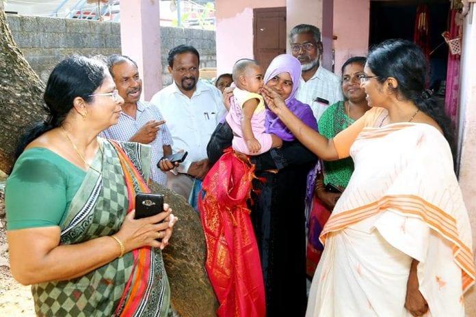 Bihari migrant woman, topper, literacy examination, Malayalam, Kerala, migrant labourers, first rank