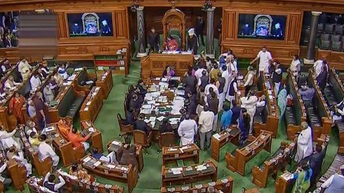 seven Congress members, suspended, Lok Sabha, Budget session, gross misconduct, snatched papers, speaker's table, Om Birla, Meenakshi Lekhi